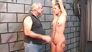 Submissive tattooed girl getting whipped hard in kinky bondage video